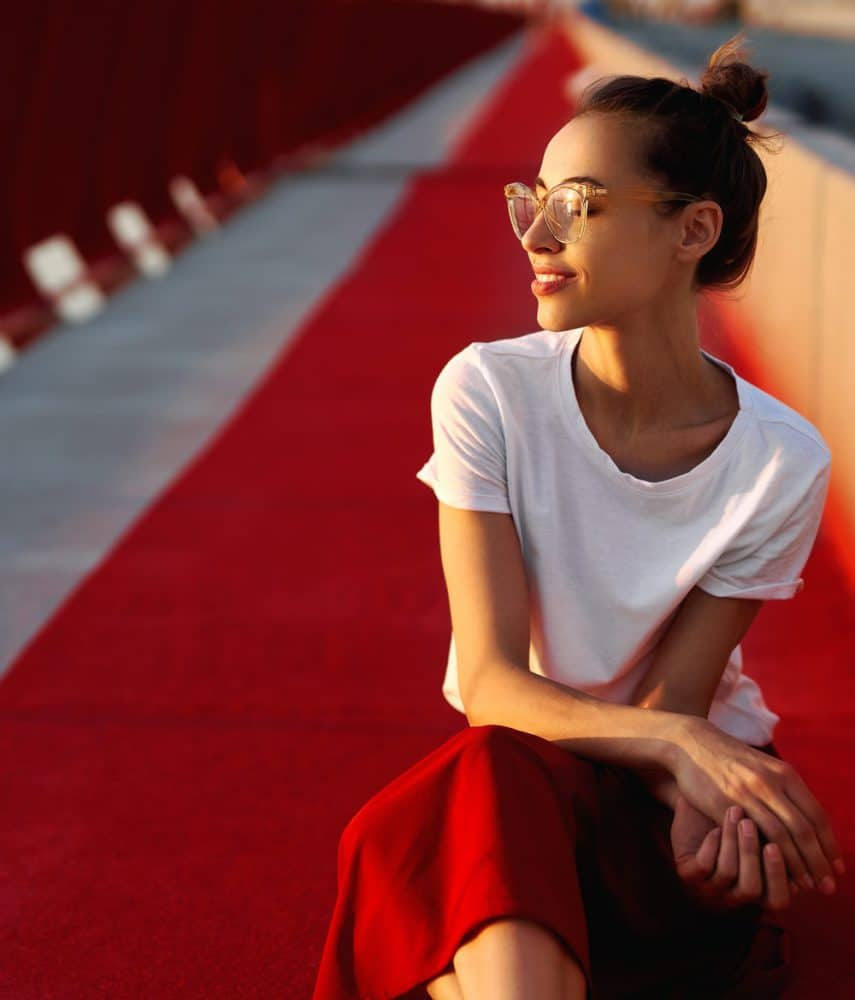 woman-sitting-on-red-carpet